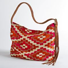 A pattern inspired by zelij, the intricate, geometric tiling style found covering the medieval mosques and modern shopping centers of Morocco, decorates this red tote bag. #summer Moroccan Zelij Hobo Bag | National Geographic Store