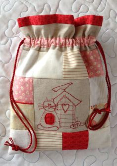 Patchwork drawstring bag with machine embroidery centre. Made by Chris.