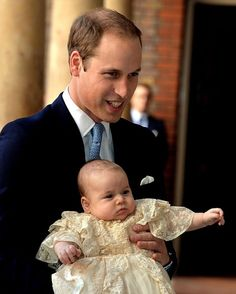 Grinning dad: The Duke of Cambridge arrived holding his first-born son Prince George who will one day be king, at The Chapel Royal, St. James Palace, October 23, 2013