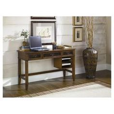 """3-drawer writing desk with a pull-down keyboard tray and open side shelving.   Product: Writing deskConstruction Material: WoodColor: WhiskeyFeatures:  Three drawersPull-down keyboard tryOpen side shelving Dimensions: 30.75"""" H x 52"""" W x 20"""" D"""