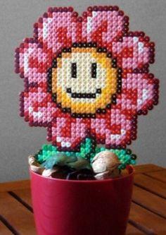 Super leuke bloem van strijkkralen en je hoeft hem nooit water te geven :-)