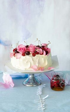 Angel food cake with jasmine-scented berries and cherries, garnished with rose petals