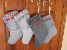 Christmas stockings made from denim jeans and lined with red fabric. Would personalize each with name on the pocket. Like the buttons, but would switch them up to add personality. DLW