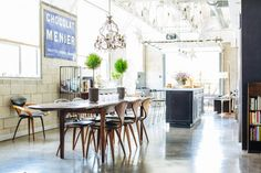 Joan McNamara LA loft with dining table and Cherner chairs