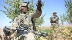 Spc. Cameron Rylander points to a gravel field from which rocket attacks against Forward Operating Base Shank were launched the previous night during a patrol, Oct. 5, 2014. (Jad Sleiman/Stars and Stripes)