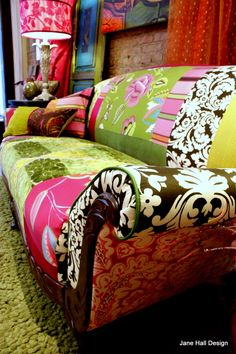 Vintage 20's carved wood show Upholstered and Quiltd Designers Guild embroidered silk and cut velvets, in magenta, pumpkin spring printed cottons and plum