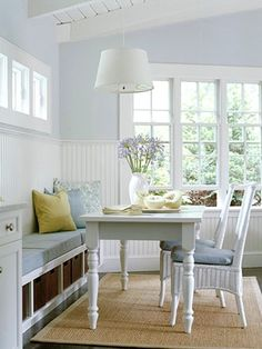 Simple white kitchen dining room booth