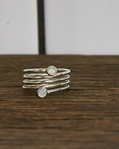 HOLLY RYAN FLOW OF IONS OPAL RING $165.00  Spiral sterling silver ring featuring 2 x 4mm white opals.