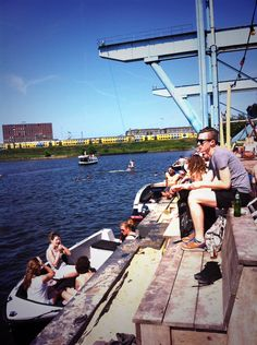 Swimming and jumping off a rope at Amsterdam Roest, our own city beach and relax haven