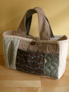 Maybe I could make a pattern to make something like this. I like the quilting done on the bag.