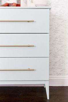 This dresser from Smitten Studio is just a humble Tarva, but little details, like the brass handles and the angled cut to the legs, take it to the next level.