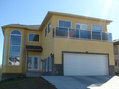 Nothing says retro like bright colours. This yellow stucco siding needed Stonetile's Charcoal selections to surround the garage and windows. Not so much of a modern look but still a bright design for the homeowners.
