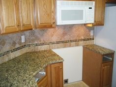 tile backsplash granite countertop oak colored cupboards santa cecilia granite with tile backsplash
