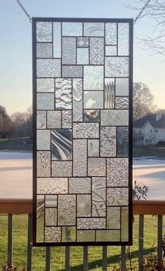 This stained glass panel is a sampling of textures of clear glass in a geometric abstract pattern. The panel is approximately 26 3/4 x 11 3/4.  The panel can be hung in either vertical or horizontal direction. The patina on the solder is black and the zinc frame is left in the silver tone. If shipping cost is less I will refund the overage.  To see more abstract geometric panels http://www.etsy.com/shop/sghovel?section_id=10763111  To see all of my items sg...