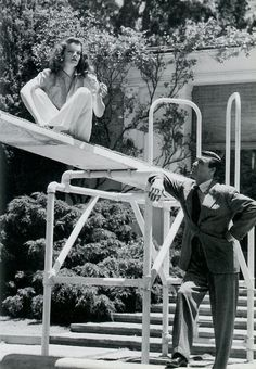 "Katharine Hepburn and Cary Grant on the set of director George Cukor's ""The Philadelphia Story"" (1940)."