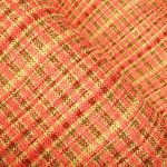 Pretty Plaid Upholstery in Coral.  A blend of pinks, greens and coral hues coupled with the soft chenille feel give this fabric a competitive edge.  A textured fabric, perfect for sofa or chair re-upholstery projects, that is interior designer quality and offered at a great price.