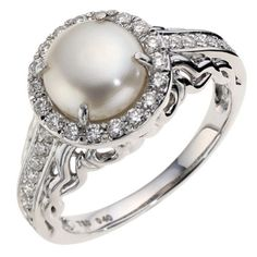 pearl engagement ring...unique. But don't like the bulky band.