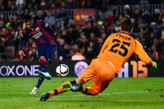 Neymar Photos Photos - Neymar of FC Barcelona scores the opening goal past Przemyslaw Tyton of Elche FC during the Copa del Rey Round of 16 First Leg match between FC Barcelona and Elche CF at Camp Nou on January 8, 2015 in Barcelona, Spain. - Barcelona v Elche