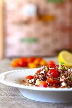 Vegetarian Mediterranean Quinoa Salad    serves 4    Ingredients:  1 cup dry quinoa  2 cups water  2 cups sliced grape tomatoes  1 cucumber, peeled and chopped  1/2 cup sliced kalamata olives  3/4 cup feta cheese  1 1/2 T extra virgin olive oil  1/2 lemon, juiced  1 tsp dry oregano  1 tsp salt  1/4 tsp black pepper   Fl...