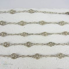 (http://www.addysvintage.co.uk/vintage-french-800-900-silver-fancy-link-chain-antique-ridged-design-alternating-link-necklace-110-cm-43-3-inches/) My most recent favorite!  A great length, interesting links, and so wearable!