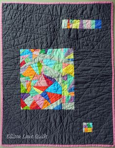 solids improv piecing surrounded by dark grey