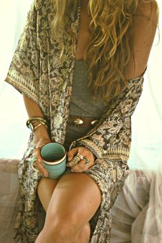 Sexy boho style. Pretty kimono, casual grey mini dress, studded brown leather belt, stacked bohemian adornment, sun kissed brunette locks and a gorgeous tan.