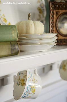 Using china and pumpkins for a fall mantel. Beautiful!