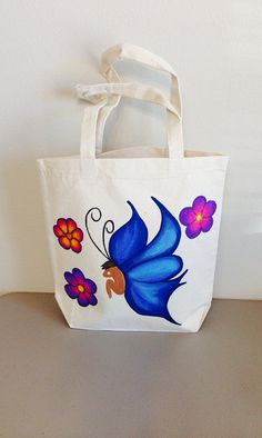 Items similar to Fairy Tote Bag, Hand Painted Fairy and Flowers, Market Bag, Tote Purse Bag, Green Grocery Bag on Etsy Painted Canvas Bags, Canvas Tote Bags, Diy Tote Bag, Tote Purse, Butterfly Bags, Potli Bags, Jute Bags, Linen Bag, Fabric Bags