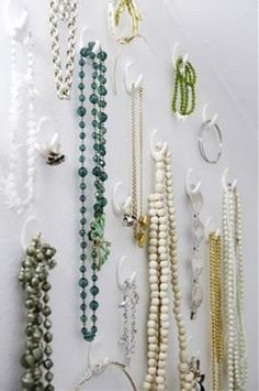 Jewelry organization idea- using Command hooks is a quick and easy idea that is also easy to change when needed