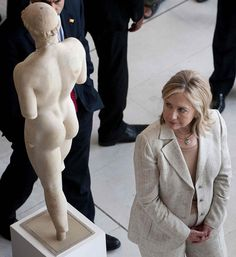 Timing......      Hillary Clinton looks at a statue as she tours the Acropolis Museum in Athens