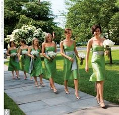 Green and grey dresses, with parasols instead of flowers.