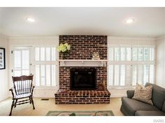 Unique contrast of the brick fireplace with the white mantel. 9618 Old Bonhomme Road, Saint Louis, MO.