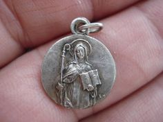 Religious antique silvered French medal of Saint Odilia.