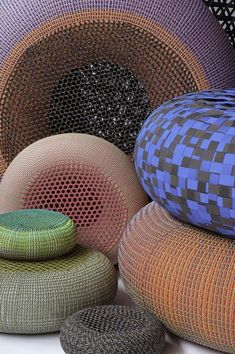 bertjan pot employs flyknit technology to create 'resting pods' in which he weaves ropes and laces around inner tubes. using basket weaving principals, the seating objects are an exercise in fiber-placement and lightweight constructions.
