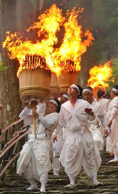 Nachi no Hi Matsuri fire festival in Japan ~ by looking at the facial expressions you can see how heavy those baskets are, and how dangerous.