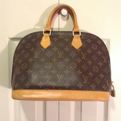 PRICE DROP TODAY ONLY Authentic Louis Vuitton Alma Price drop. Today only!!! Until 12am central time! Leather is in great condition, does show normal wear. Very light pen mark on one of the handles where it attaches to the bag. Inside is in excellent condition. Zipper is slightly tight on one side where it curves. Comes with lock and 2 keys. Louis Vuitton Bags Satchels
