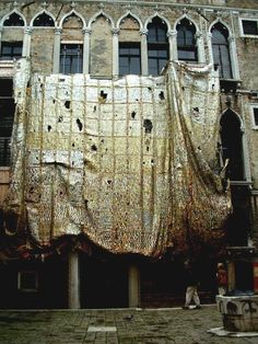 El Anatsui curtain of recycled metal bits, hung in front of Palazzo Fortuny, Venice.