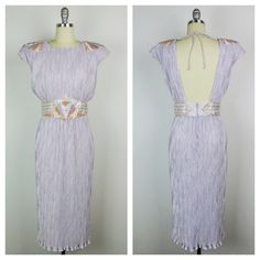 Stunning 1980s backless crinkle lavender cocktail dress with pastel colored sequins and beads at the waist and shoulders. Back zipper, tie across