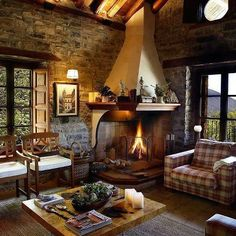 This cabin has stone interior walls but they left the exposed timbers in the ceiling.