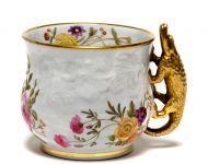 Cabinet cup, c. 1820  Spode's formula for bone china produced a porcelain that was white, very translucent, and stable in the traditional Staffordshire firing process. Bone china, unlike true Chinese porcelain, used a sequence of biscuit then glost schedules and firing technologies similar to those of earthenware.