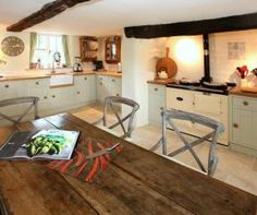 photo of country kitchen beige brown kitchen kitchen/diner with butler sink flooring tiled splashback tiles exposed beams stone floor and ag...