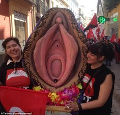 Three feminist protesters who carried a giant plastic vagina (pictured) through Sevila, Spain, are facing court after the protest was deemed a religious hate crime