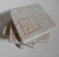 Use code Holiday20 to save 20% on any $20 purchase through 12/14/14.  Sepia leaf print ivory travertine stone coaster by midwooddesign