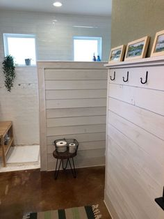I wanted to finish off the bath with an accent wall using shiplap and contrast paint. So with the help of my hubby, we painted and installed a shiplap accent wall. This is the finished wall along with the pony wall dividing the shower from the rest of the room. This is a wheelchair accessible shower and I wanted the wall shiplapped as well to complete the look of my farmhouse industrial vibe. The hooks were an Etsy purchase and are forged metal that I sprayed black to prevent from ru… Bathroom Accent Wall, Bathroom Accents, White Bathroom, Wheelchair Accessible Shower, Half Wall Shower, Pony Wall, Home Staging Tips, White Shiplap, Dining Decor
