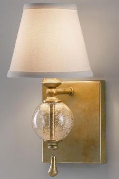 The classically designed Argento Wall Sconce in Silver Leaf from Feiss features a vintage-style mini-lamp that would look great in a bathroom or powder room. This sconce has a translucent spherical base and a hanging gold accent pendant. Outdoor Sconces, Outdoor Wall Lighting, Cool Lighting, Wall Sconce Lighting, Interior Lighting, Wall Sconces, Sconces Living Room, Living Room Lighting, Wall Fixtures
