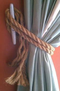 boat cleat and rope tie backs for grommet top curtains.....bedrooms, and living room?