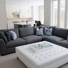 http://www.ireado.com/minimalist-and-modern-black-and-white-living-room-ideas/ Minimalist And Modern, Black And White Living Room Ideas : Spacious Luxurious Living And Family Rooms With Large White Tufted Ottoman And Tr...