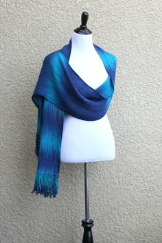 "<p>Hand woven long scarf with gradually changing colors from dark blue to turquoise.</p> <p>Measures: <br>L: 78"" with 6"" fringe on both ends W: 11""</p> <p>Care instructions... #kgthreads"