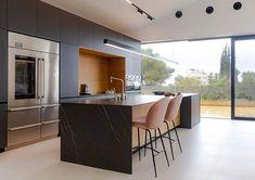 Modern kitchen with white ceramic tile flooring black cabinets black quartz waterfall countertops Tile Flooring, Types Of Flooring, Modern Kitchen Design, Kitchen Designs, Ceramic Floor Tiles, Black Quartz, Black Cabinets, Home Interior Design, Countertops