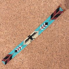 Thunderbird With Arrows Bead Loom Bracelet Bohemian Boho Artisanal Jewelry Western Bead Santa Fe Native American Inspired Southwestern Thunderbird With Arrows Bead Loom Armband Bohemian von PuebloAndCo Seed Bead Patterns, Beading Patterns, Beading Ideas, Beading Supplies, Perle And Co, Armband Tutorial, Beads Tutorial, Bead Loom Bracelets, Pandora Bracelets